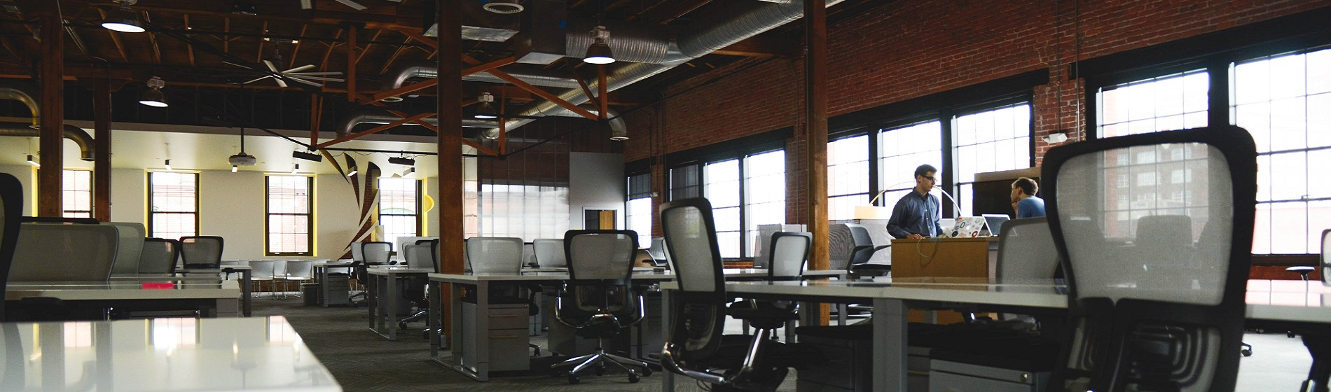 long view of industrial office space with desks and chairs